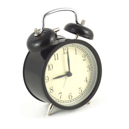 Alarm clock in black case shows 9 hours, photo isolated on white close up photo