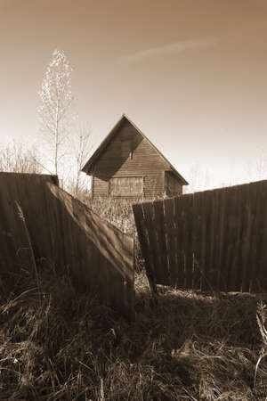 genre: Abandoned uninhabited house in countryside  Genre photography, sepia style Stock Photo
