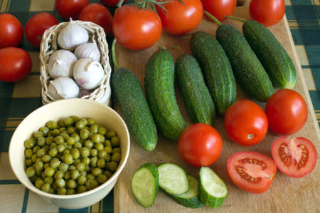 Still life with many ripe vegetables on kitchen table closeup photo