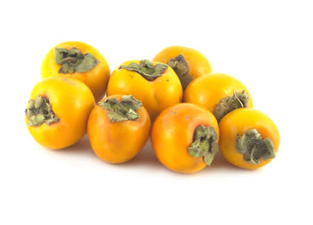 Ripe orange persimmons isolated on white close up photo