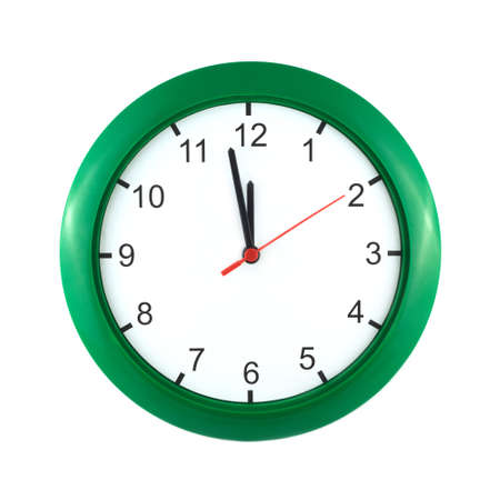 Big wall clock shows almost twelve o clock isolated on white close up photo