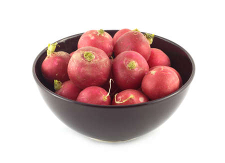 red radishes in purple bowl closeup isolated on white photo