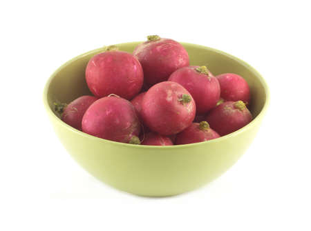 red radishes in green bowl closeup isolated on white photo