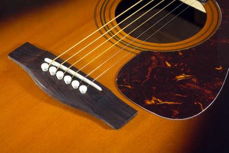 showbusiness: Classic acoustic guitar sunburst color top fragment with six strings closeup