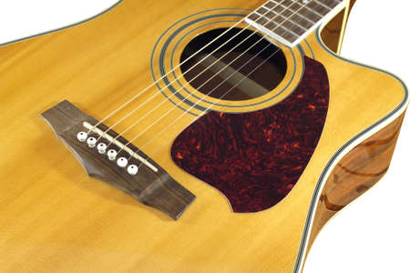 showbusiness: Classic acoustic guitar natural color top fragment with six strings isolated on white closeup Stock Photo