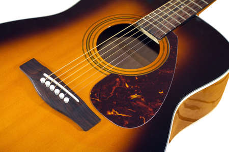 showbusiness: Classic acoustic guitar sunburst color top fragment with six strings isolated on white closeup Stock Photo