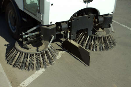 Part of road cleaning machine with front round brushes closeup photo