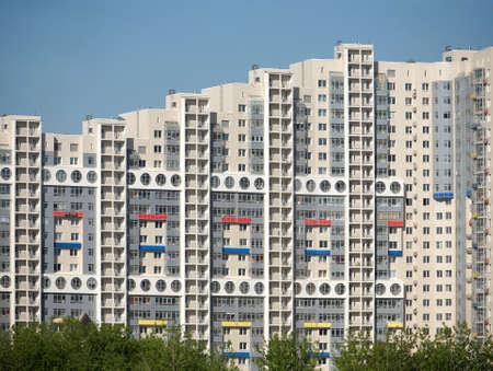 residential neighborhood: Built multi-storey residential house in a new neighborhood over clear blue sky