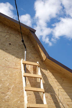 Power supply mounting on new built suburban house in summer day  Vertical photo photo