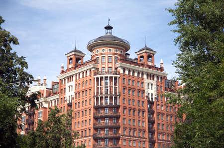 elites: Modern brown brick residential building front view