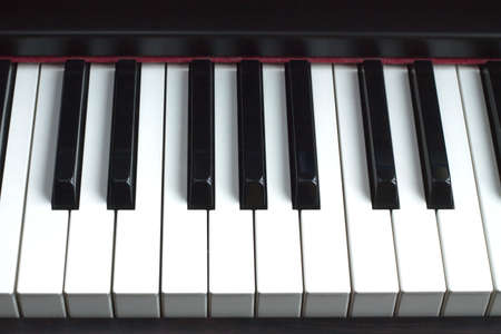Piano keyboard. Front view closeup photo