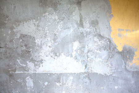 stucco house: Wall in gray stucco inside house in process of repair as background closeup Stock Photo