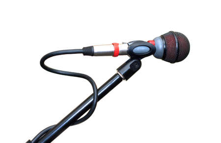 Vocal microphone isolated on white background. Side view close up photo