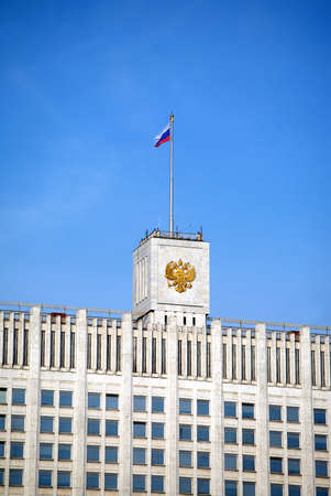 house coat: White house. Top of Russian house of parliament in Moscow with flag and coat of arms close up