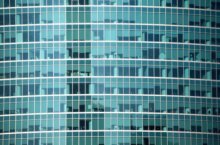 panoramic windows: Glass wall of modern office building with many large panoramic windows in business cluster front view close-up