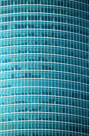 panoramic windows: Glass wall of modern office building with many large panoramic windows in business cluster vertical front view close-up
