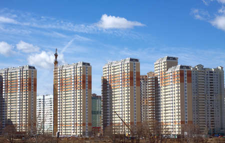 constructed: New high modern constructed city buildings over clear cloudless blue sky front view