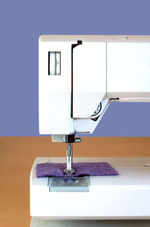 Electric Sewing Machine On Brown Wood Table Indoor Vertical View Amazing What Is A Vertical Sewing Machine