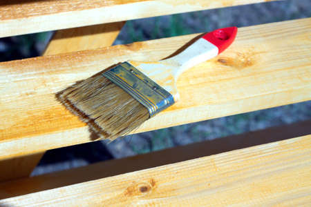 shelving: Brush lying on a painted wooden shelving surface. Horizontal photo closeup Stock Photo