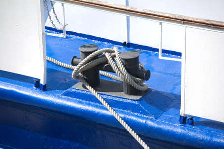 bollards: Bollards with thick hemp rope on the deck of a ship closeup Stock Photo