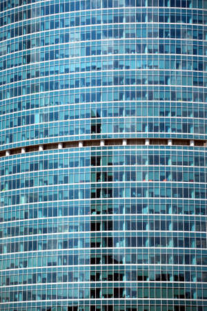 panoramic windows: Modern office building glass wall with many large panoramic windows in business cluster vertical front view close-up