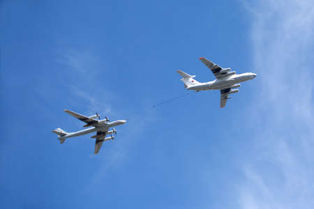 supersonic transport: MOSCOW - MAY 9: Russian military transport plane Il-78 refueling tankers and Tu-95 turboprop strategic bomber-missile Bear in flight on parade on May 9, 2015