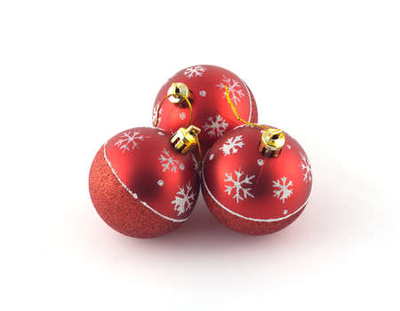 'christmas ball': Three red Christmas balls isolated on white background. Studio shot closeup