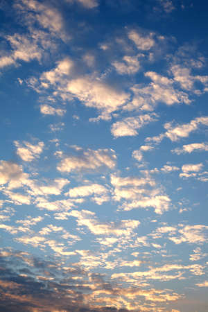 crepuscle: Beautiful celestial sunset with white clouds high in the stratosphere in the evening. Vertical view