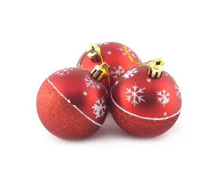 Three red Christmas balls isolated on white background. Studio shot closeup