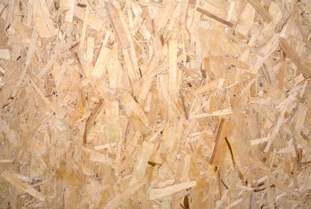 oriented: Oriented Strand Board. Wooden panel made from pressed sandy brown wood shavings as background horizontal view closeup Stock Photo