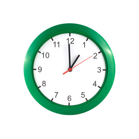 o'clock: One oclock on big wall clock in green case isolated on white background closeup
