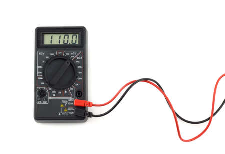 volts: Digital multimeter with red and black wires shows 110 volts on LCD display. Electronic multimeter isolated on white background closeup