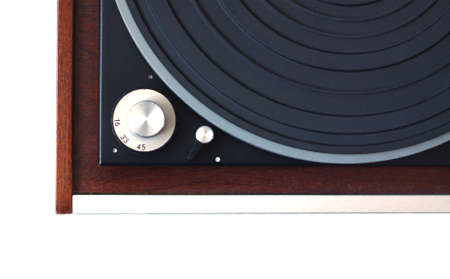 record player: Part of vintage record player with wood finish top view isolated on white horizontal photo closeup