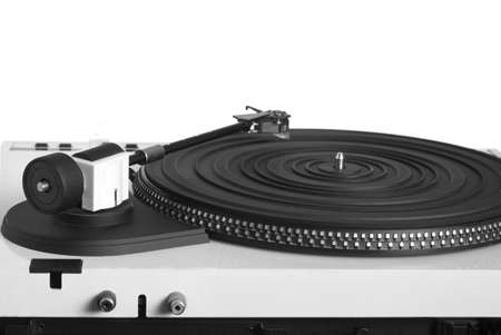 output: Turntable with right tonearm in silver case with rubber mat on black disc with stroboscope marks with output connectors rear view isolated on white background. Horizontal view closeup