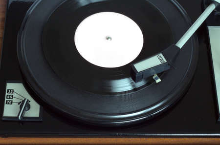 Old vintage record player playing vinyl record with pink label. Top view horizontal photo view Stock Photo