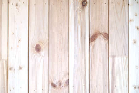 sandy brown: Wall from vertical sandy brown vertical oriented wooden planks as background horizontal view closeup