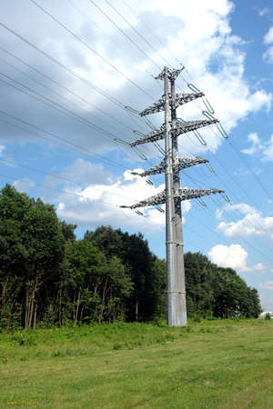 prop: High-voltage power line gray metal prop with many wires vertical view closeup Stock Photo