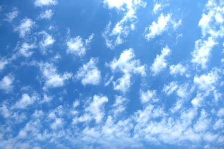 stratosphere: Beautiful celestial landscape with white clouds high in the stratosphere on a sunny summer day horizontal view Stock Photo