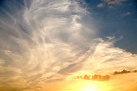 crepuscle: Beautiful colorful celestial sunset with white clouds high in the stratosphere in the evening. horizontal view