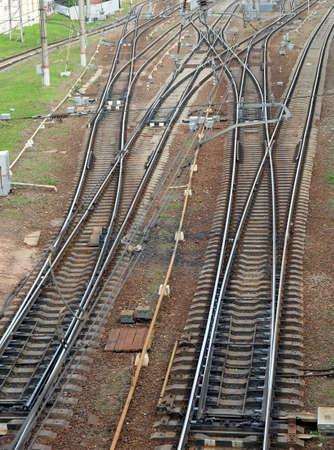 railroad tracks: Industrial landscape with railroad tracks on concrete railway sleepers, arrows and track equipment vertical top view Stock Photo