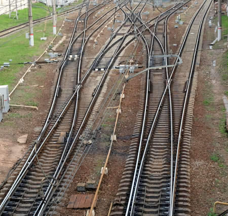 railroad tracks: Industrial landscape with railroad tracks on concrete railway sleepers, arrows and track equipment top view