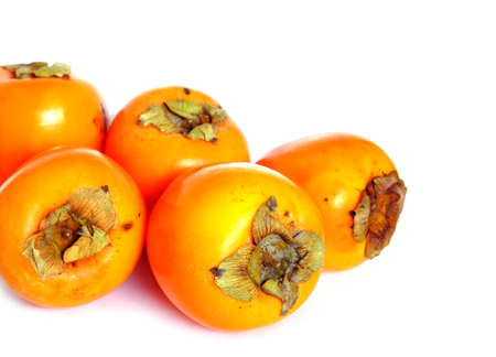 Still life with five ripe big persimmons isolated studio shot front view closeup Stock Photo