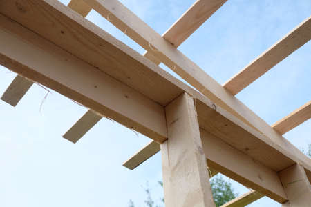 Roof lathing mounting inside house. Wooden country house construction