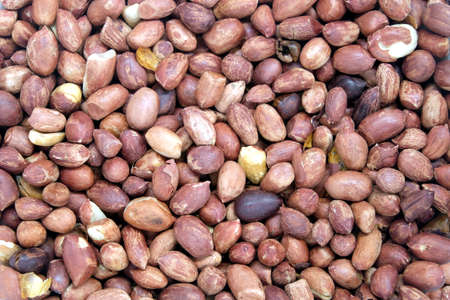 Lot of roasted peanut fruits as background top view closeup
