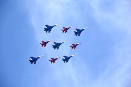 MOSCOW, RUSSIA - MAY 9, 2015: Aerobatic groups Russian Mighty Fighters on Maiden and Swifts on MIG-29 and SU-27 on May 9, 2015 in Moscow