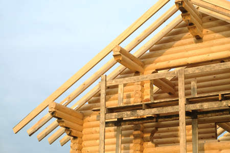 Process of wooden house. Wooden country house construction