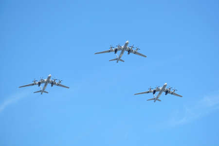MOSCOW, RUSSIA - MAY 9, 2018: Three Russian military turboprop strategic bombers-missile Tu-95 Bear in the sky on parade on May 9, 2018 Editorial