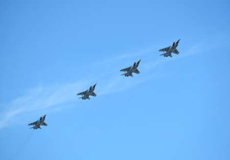 MOSCOW, RUSSIA - May 9, 2018: Group of Russian military supersonic high-altitude all-weather long-range interceptor MIG-31 (Foxhound) in flight in the blue sky on parade on May 9, 2018