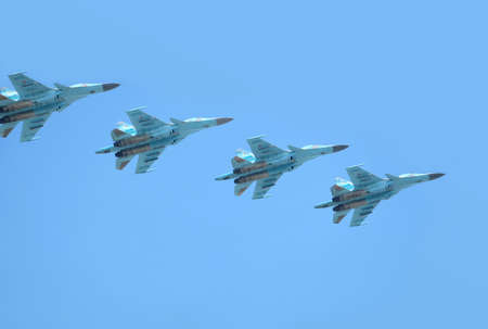 MOSCOW, RUSSIA - May 9, 2018: Group of Russian military supersonic high-altitude all-weather long-range interceptor SU-30SM (Flanker-C) in flight in the blue sky on parade on May 9, 2018
