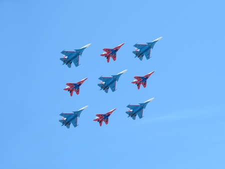 MOSCOW, RUSSIA - MAY 9, 2018: Aerobatic groups Russian Mighty Fighters demonstrates Kubinsky Diamond in flight against blue sky on parade flight on May 9, 2018 Editorial